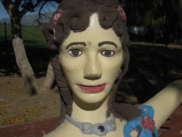 A close up of a female figure. John Ehn's Trapper's Lodge.